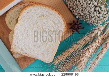 Sliced Soft And Sticky Delicious White Bread On Wood Cutting Board Prepare For Breakfast On Blue Woo
