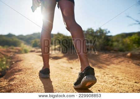 hiker walking on dirt path close up on shoes while walking