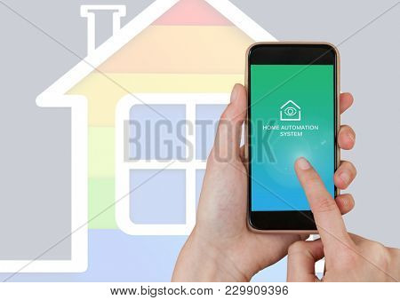 Digital composite of Hand touching mobile ohone with Home automation system App Interface