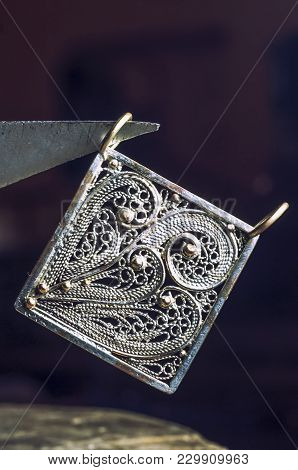 The Work Of Jewelers. Trial Jewelry Of Semiprecious Metals. Square Brooch. Selective Focus. Macro Ph