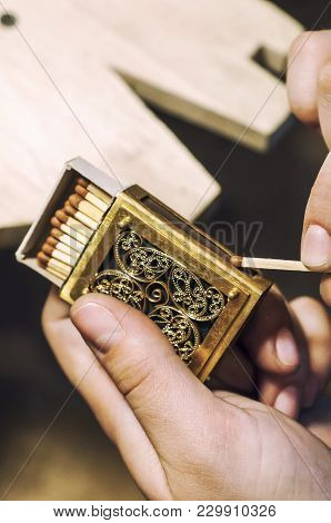 The Work Of Jewelers. Teal Jewelry Of Semi Precious Metals. A Box Of Matches. Selective Focus. Macro