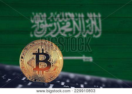 Bitcoin. Bitcoin On The Background Of Flag Saudi Arabia.