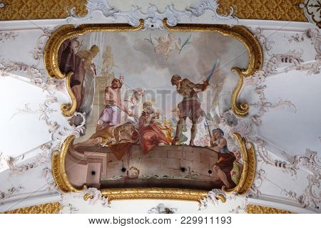 AMORBACH, GERMANY - JULY 08: Martyrdom of St. Faustinus and Simplicius, beautiful religious fresco by Matthaus Gunther in Benedictine monastery church in Amorbach in Bavaria, Germany on July 08, 2017.