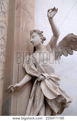 AMORBACH, GERMANY - JULY 08: Angel statue in Amorbach Benedictine monastery church in the district of Miltenberg in Lower Franconia in Bavaria, Germany on July 08, 2017.