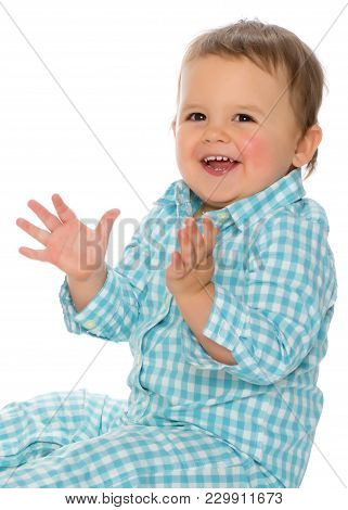 The Little Boy Claps His Hands. The Concept Of A Happy Childhood, The Development Of A Child In The