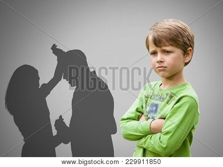 Digital composite of Boy against grey background with arms crossed concerned and parents arguing violently