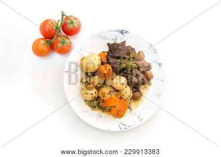 Beef meat stewed with potatoes-Traditional French cuisine Beef Bourguignon potatoes carrots in persillade