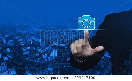Businessman Pressing Camera Flat Icon Over Modern City Tower, Street And Expressway, Business Camera