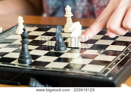 The White Chess On Women Hand Is Fighting With Black, Think, Discuss, Committed, Competition, Winner