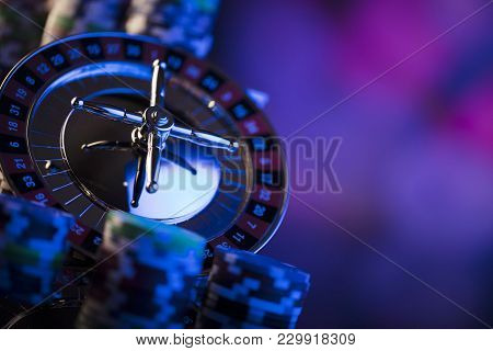 Casino. High contrast image of casino roulette. Poker chips. Bokeh background.