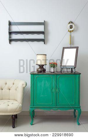 Wooden Green Vintage Sideboard With Empty Wooden Ornate Brown Desktop Photo Frame, Flower Planter, T