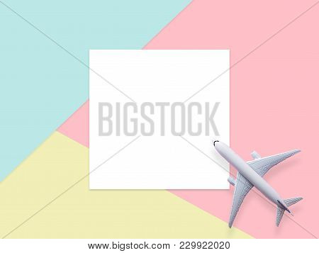 Travel By Plane Concept.simply Flat Lay Design Of Travel Concept With Plane On Blue , Yellow And Pin