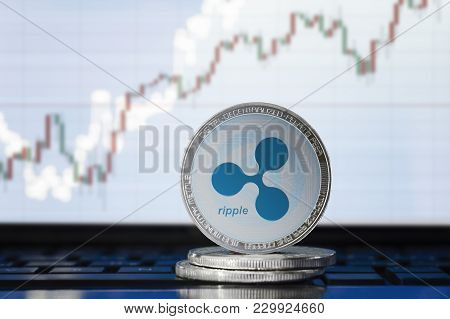 Ripple (xrp) Cryptocurrency; Physical Concept Ripple Coin On The Background Of The Chart
