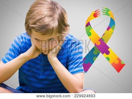 Digital composite of Boy against grey background with autism color spectrum hands ribbon