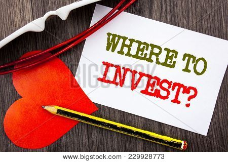 Handwriting Text Showing Where To Invest Question. Business Concept For Financial Income Investing P