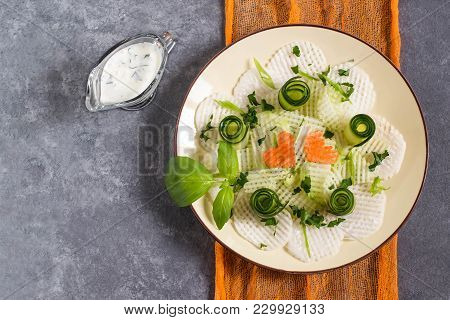 Vitamin Salad From Daikon With Cucumber And Herbs. Served With Yoghurt Sauce. Detox. Vegetarian, Hea