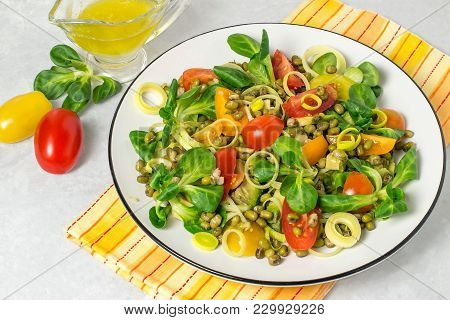 Delicious And Healthy Salad With Beans Mung, Avocado, Leek, Cherry Tomatoes, Corn Lettuce On Light G