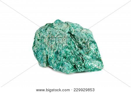 Macro Shooting Of Natural Gemstone. Raw Mineral Fuchsite. Isolated Object On A White Background