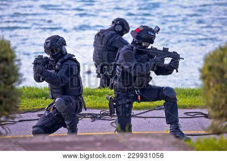 Special Forces Tactical Team Of Three In Action, Unmarked And Unrecognizable Swat Team