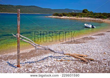 Idyllic Rocky Beach Sakarun And Small Boat On Dugi Otok Island, Archipelago Of Dalmatia, Croatia