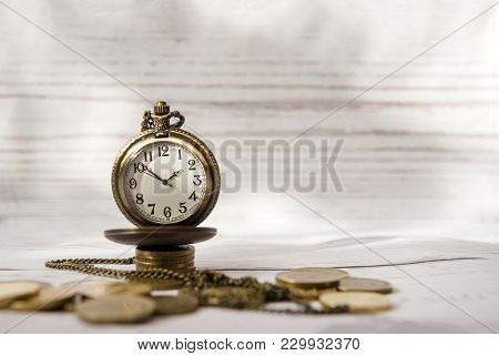 Time And Money, Vintage Clock, Pocket Watch  On A Pile Of Coins, Watch Face, Hands