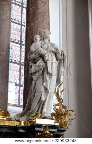 AMORBACH, GERMANY - JULY 08: Saint Anne statue on the main altar in Amorbach Benedictine monastery church in Lower Franconia, Bavaria, Germany on July 08, 2017.