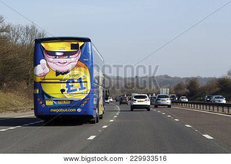 London, Uk: February 24, 2018: A Megabus In Transit On The M4. Megabus Coach Service Travels To Over