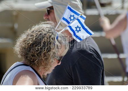 Latrun, Israel - May 02, 2017: The Patriotic Woman With Israeli Flag On His Head Celebrate Israel In