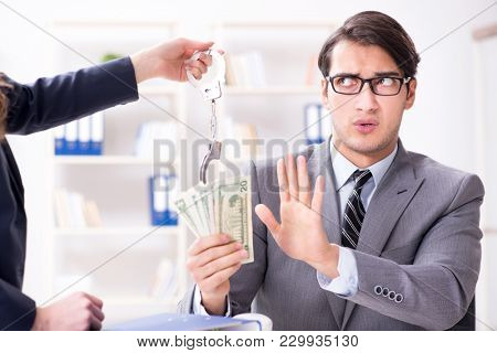 Businessmanbeing offered bribe for breaking law