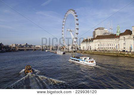 London, Uk: February 24, 2018: London Eye River Cruise Boat Passes The Millennium Wheel On The Thame