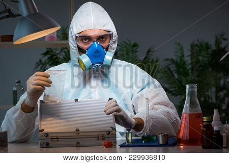 Forensic investigator working in lab looking for evidence