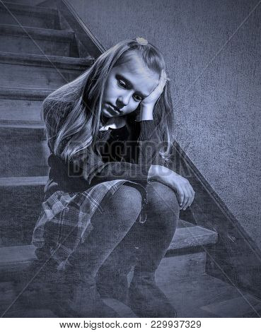 7 Or 8 Years Old Sad Depressed And Worried Schoolgirl Sitting On Staircase Desperate And Scared Suff