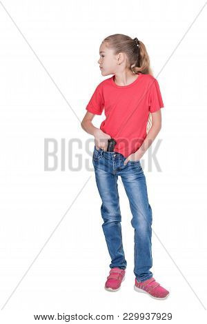 Portrait Of A Young Girl Looking Sideways With A Gun Behind Her Belt Isolated On White Background