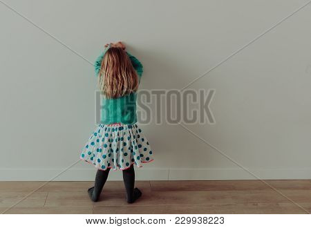 Little Girl Standing Up Against A Wall, Punishment And Discipline