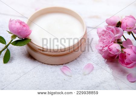 Spa Concept With Pot Of Moisturizing Cream And Beautiful Pink Roses. Spa Treatment. Spa Massage