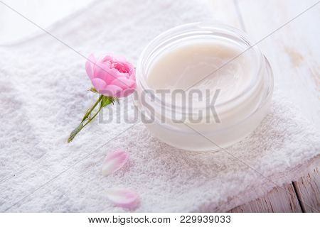 Organic Cosmetic With Rose And Pot Of Moisturizing Face Cream On White Background Top View.