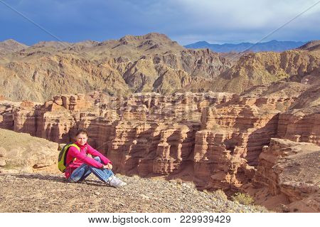 Grand Canyon Hiker Woman Resting Portrait. Hiking Multiethnic Girl Relaxing On Grand Canyon.