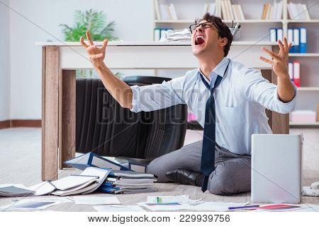 Bankrupt businessman angry in the office floor
