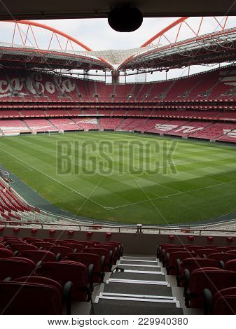 Lisbon, Portugal - July 2016: View Of Da Luz Stadium: Red Empty Seating And Green Soccer Pitch - Lis