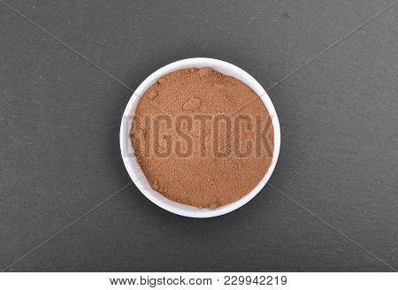 Colorful And Crisp Image Of Bowl With Cocoa Powder On Shale
