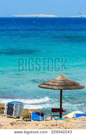 Picturesque Ionian Sea Beach Punta Della Suina,  Salento, Puglia, Italy. Gallipoli Town View In Far.