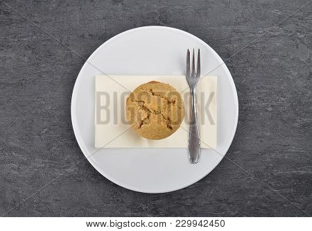 Colorful And Crisp Image Of Muffin On Plate And Shale