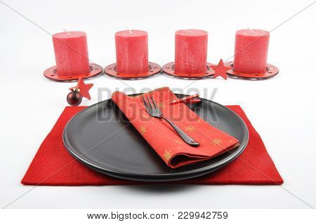 Colorful And Crisp Image Of Christmassy Table Setting With Felt And Candles