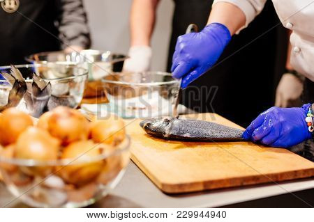 Woman Cook Preparing And Cleaning Raw Dorada Fish