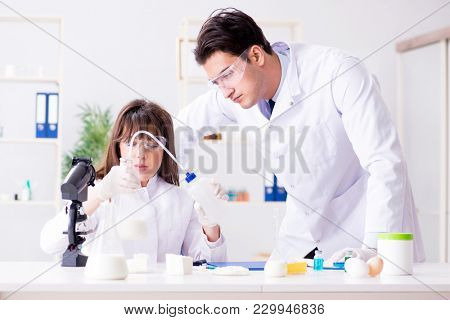 Two lab doctor testing food products