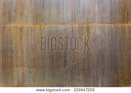 Old Rusted Metal Sheet. Rusty Surface Caused By Oxidation Iron With Blue And Brown Cracked Color. Fo