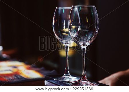 empty wine glasses on bar