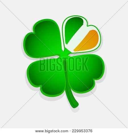 Green Shamrock With One Of The Petal Coloured Whit Irish Flag Colours Over Withe Background
