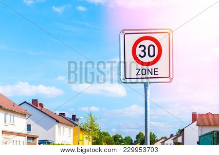 Speed Limit Sign To 30 In The Suburbs