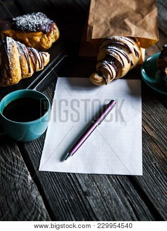 The Croissant With Coffee And Notepad The Croissant With Coffee And Notepad